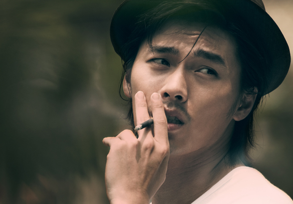Hyun Bin smoking a cigarette (or weed)