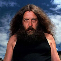Alan Moore, scraggly-bearded and wild-haired comics curmudgeon.