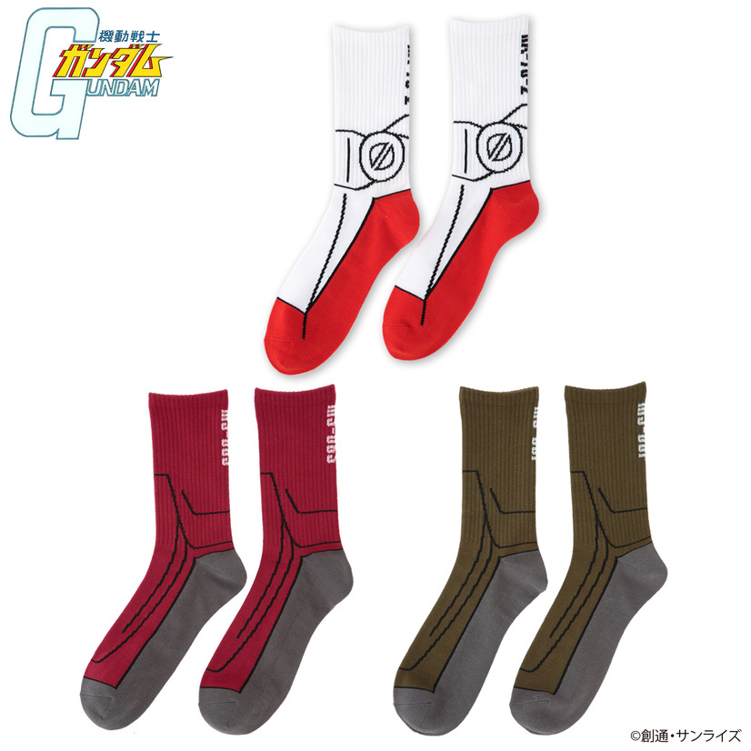 A promotional image of the BanColle! Mobile Suit Gundam MS Impersonator socks line, featuring socks that mimic the feet area of the RX-78-2 Gundam, the MS-06S custom Zaku, and the MS-06F production line Zaku.