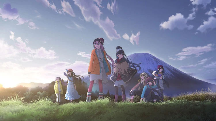 A key visual for the Laid-Back Camp TV anime, featuring the main characters gathering at a campsite at the base of Mount Fuji.