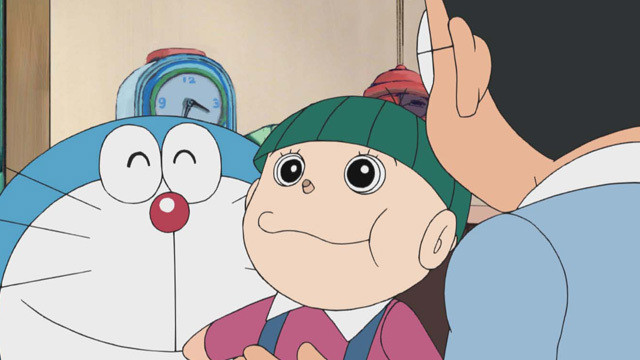 Doraemon and Nobita hold a green-haired doll