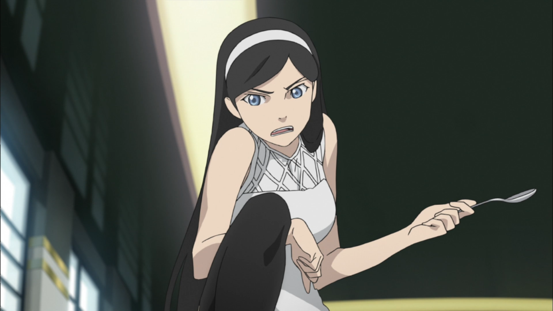 Maya Kumashiro brandishes a spoon in a threatening manner in a scene from the Occult Academy TV anime.