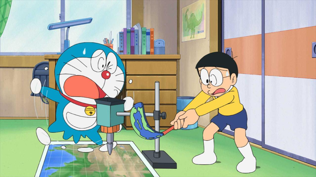 Doraemon and Nobita freak out over one of Doraemon's fantastical inventions in a scene from the Doraemon TV anime.