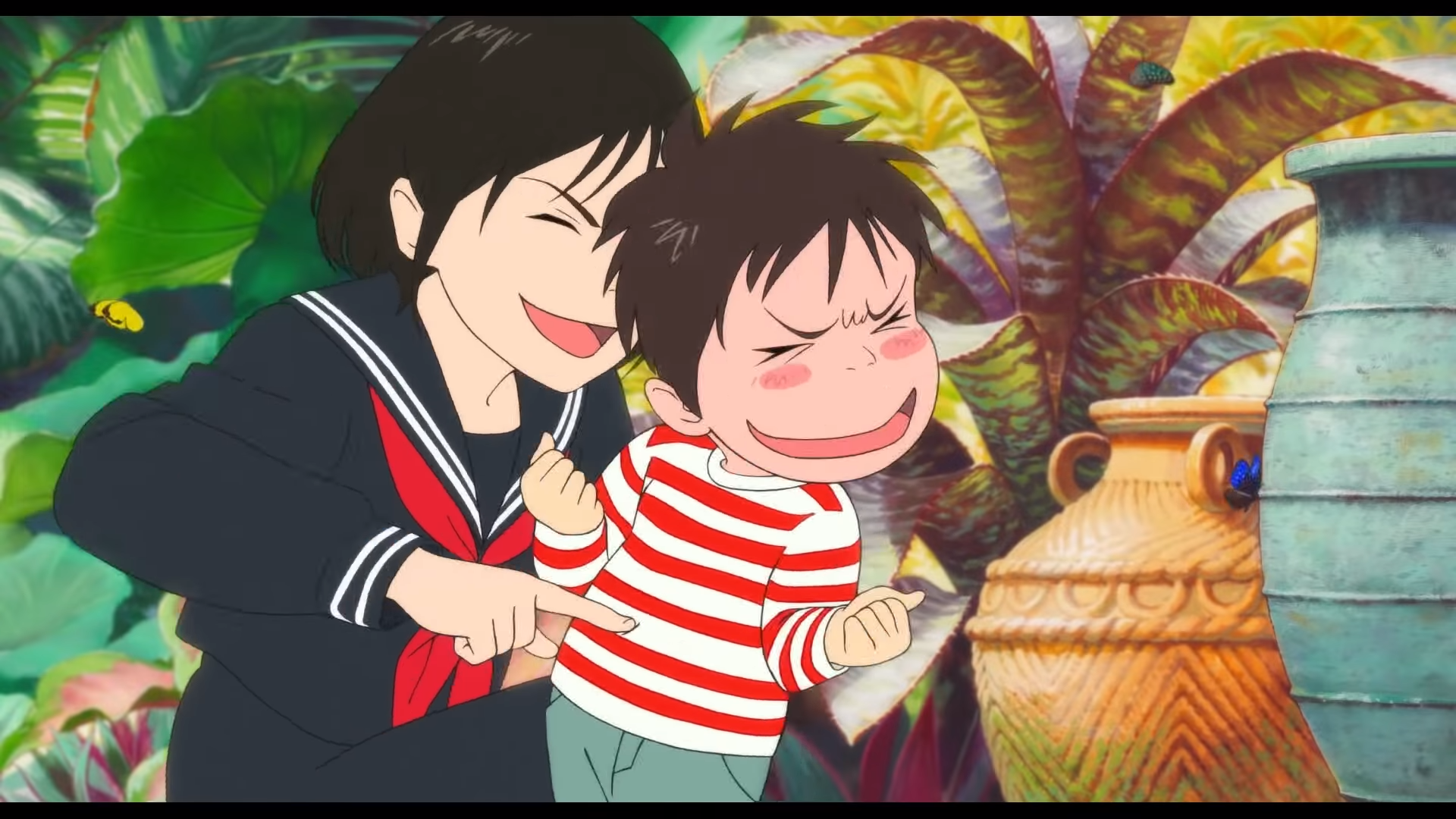 Kun and Mirai tickle each other in a playful scene from Mirai