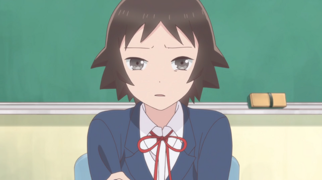 "Nozumu Tanaka, aka ""Baka"", listens to her teacher's lecture with a dull, uncomprehending expression on her face."