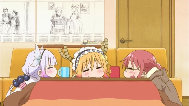 Kanna, Tohru, and Kobayashi melt into useless blobs beneath the comforting warmth of the kotatsu in a scene from the 2017 Miss Kobayashi's Dragon Maid TV anime.