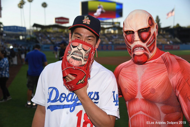 Kenta Maeda and Titan-kun pose for photos together. New best friends?