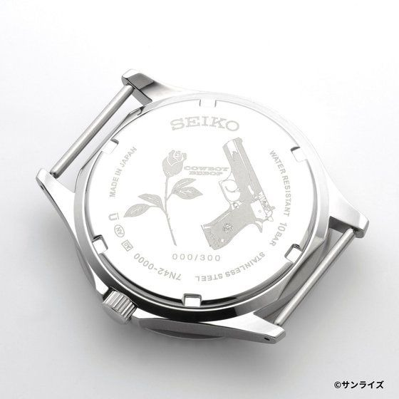 A promotional image of the SEIKO x Cowboy Bebop Wrist Watch, displaying the rear of the watch which features an engraving of the Cowboy Bebop logo, a rose, a pistol, and the watch's number in the production run.