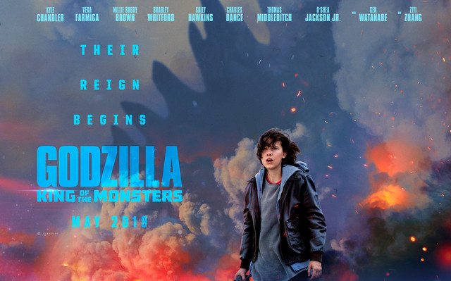 A promotional poster for Godzilla: King of the Monsters featuring actresss Millie Bobby Brown in the foreground and smoke, fire, and Godzilla in the background.