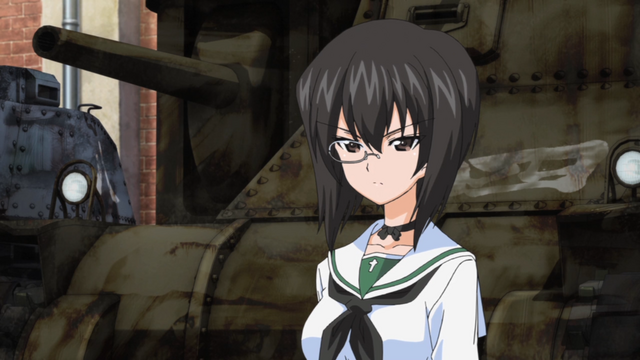 Momo Kawashima stands before a beat up old tank and glares in a scene from the 2012 GIRLS und PANZER TV anime.