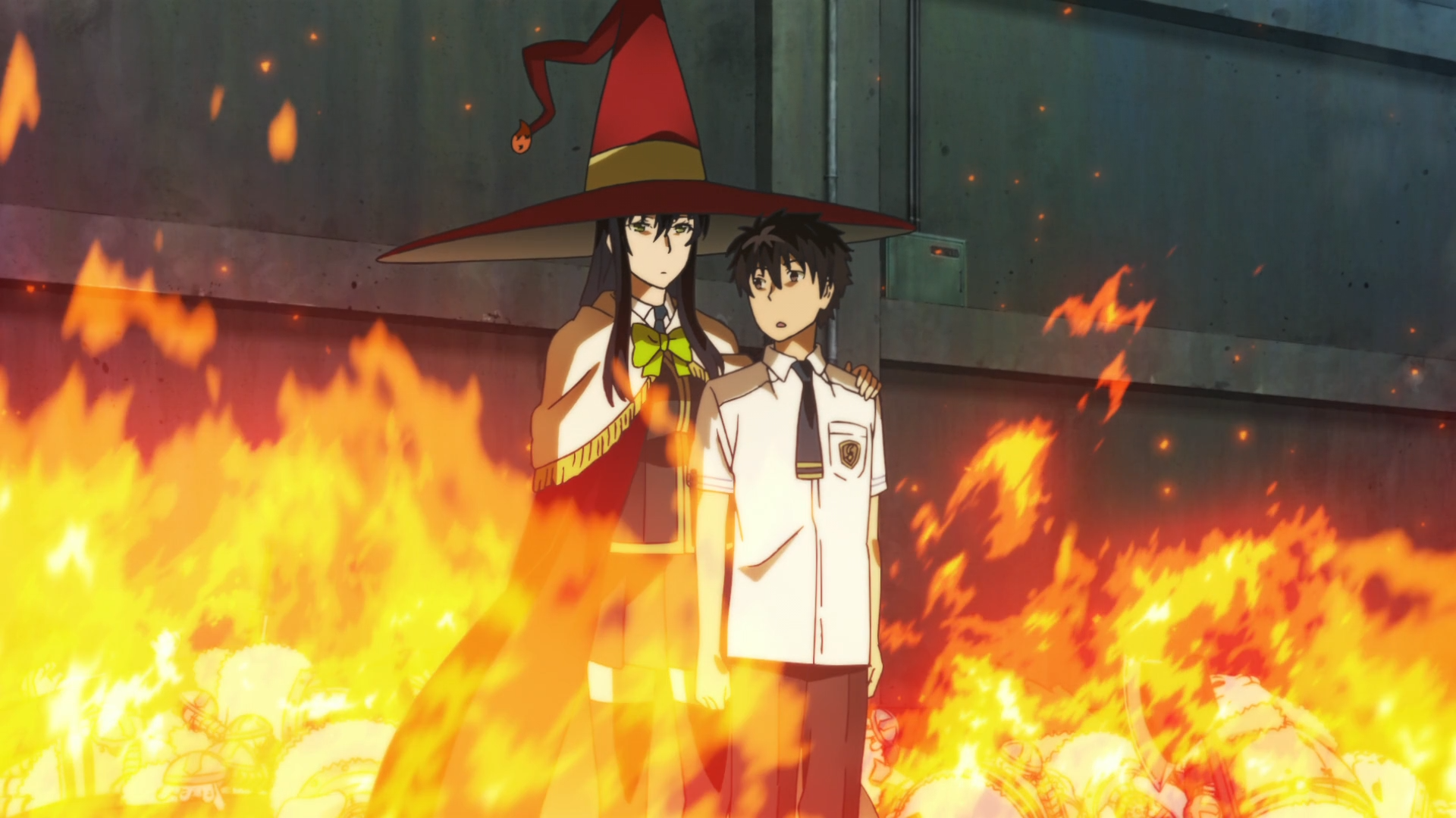 Ayaka Kagiri, the Witch of Flames, protects her charge, Honoka Takamiya, with a shield of fire in a scene from the Witch Craft Works TV anime.