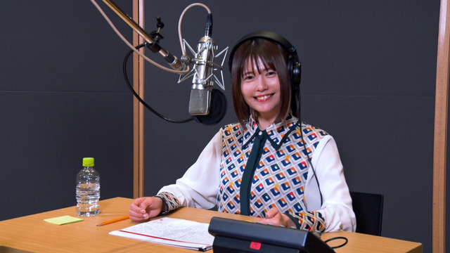 Voice actor Ayana Taketatsu sits in front of a microphone in preparation for her work on a TV commercial for the Jumputi Heroes puzzle RPG smart phone game published by LINE Corporation.