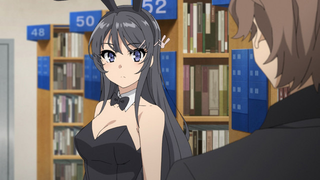 Sakuta Azusagawa is bemused to encounter Mai Sakurajima dressed as a bunny girl in a busy public library in a scene from the Rascal Does Not Dream of Bunny Girl Senpai TV anime.