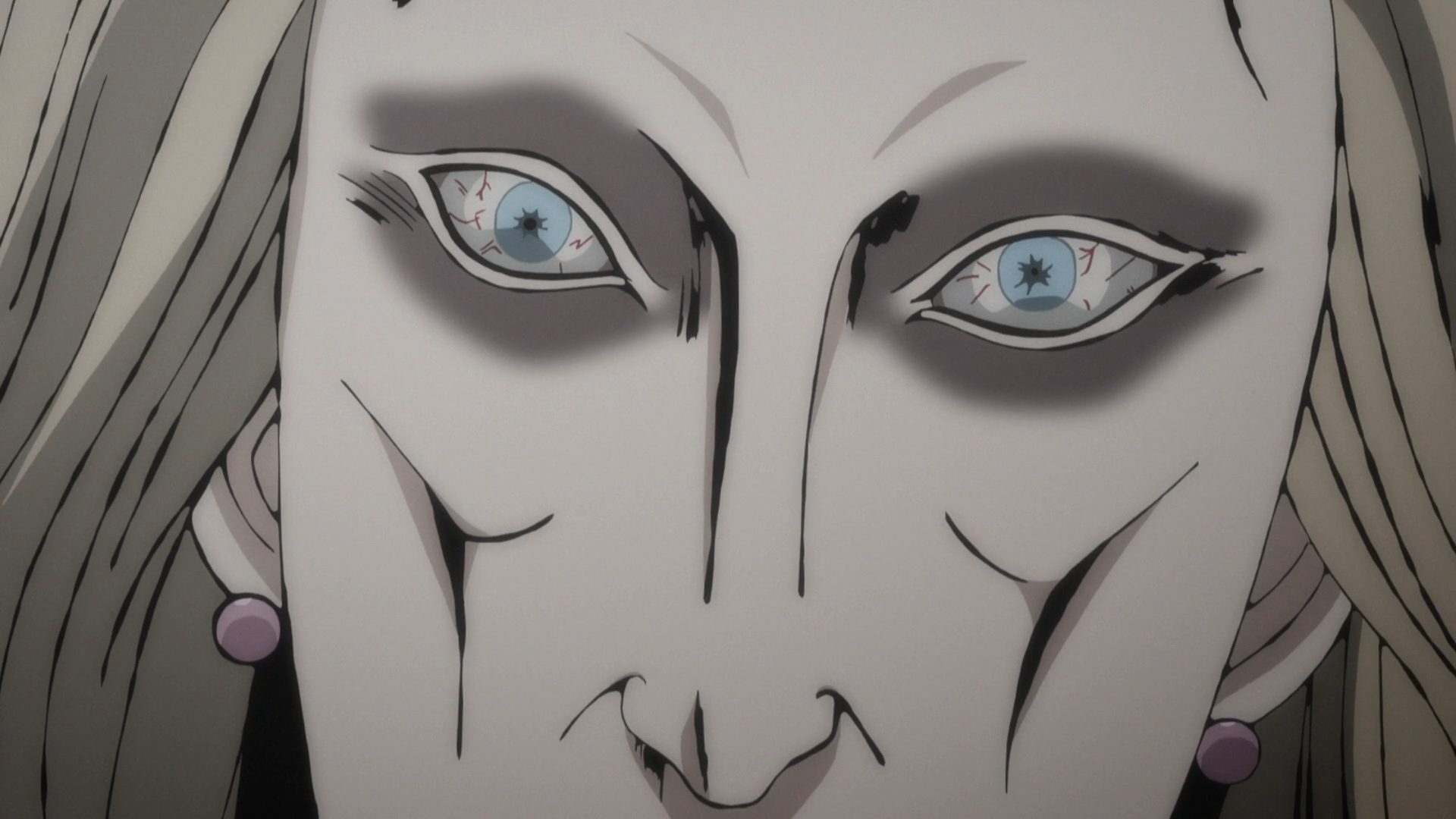 A close-up of Miss Fuchi's piercing, blood-shot eyes from the 2018 Junji Ito Collection TV anime.