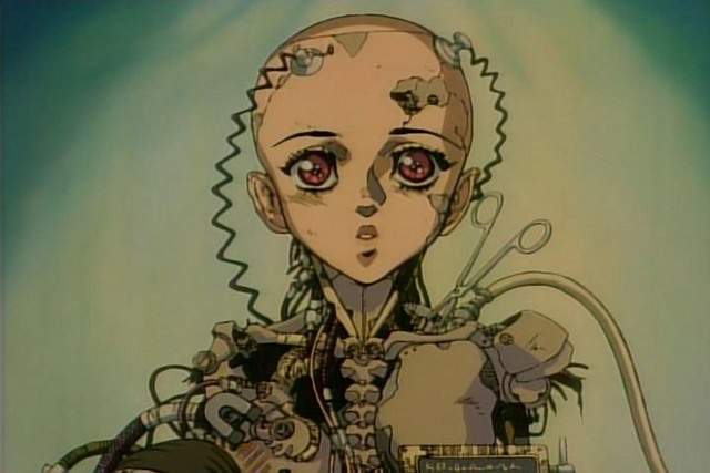 Gally, an amnesiac cybor, is resurrected by Dr. Ido after being found in a trash-pile in a scene from the Battle Angel OAV.