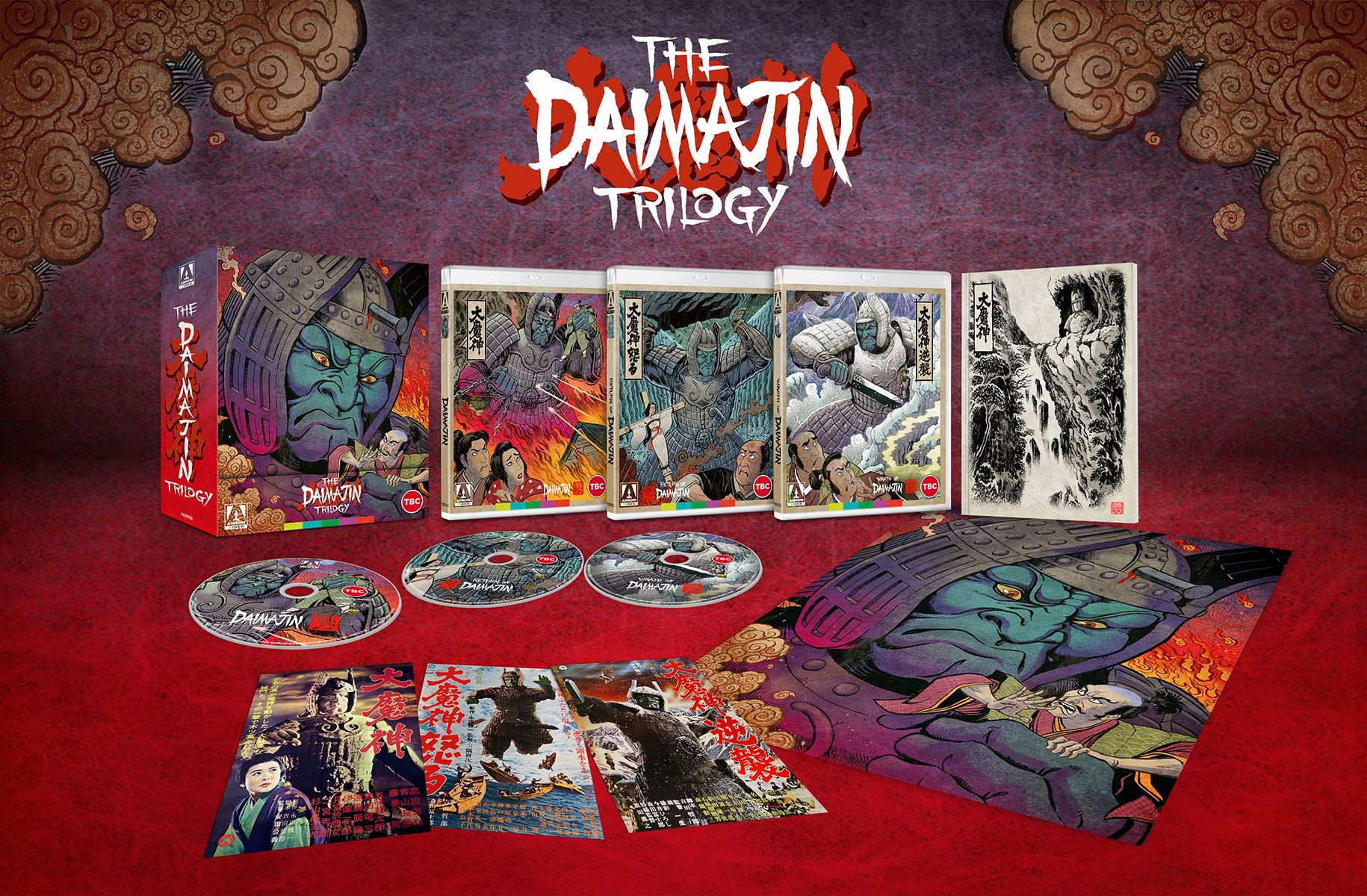 A promotional image for The Daimajin Trilogy Blu-Ray release from Arrow Films, highlighting the artwork of the box set, the cases, the discs, and the pack-in materials.
