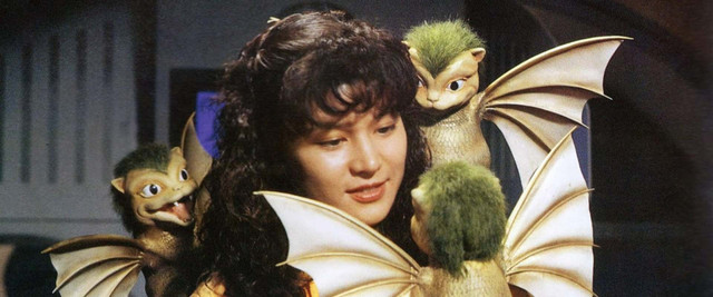 Emmy Kano (played by actress Anna Nakagawa) is charmed by three adorable Dorats, the chronological precursors to the monstrous King Ghidorah.