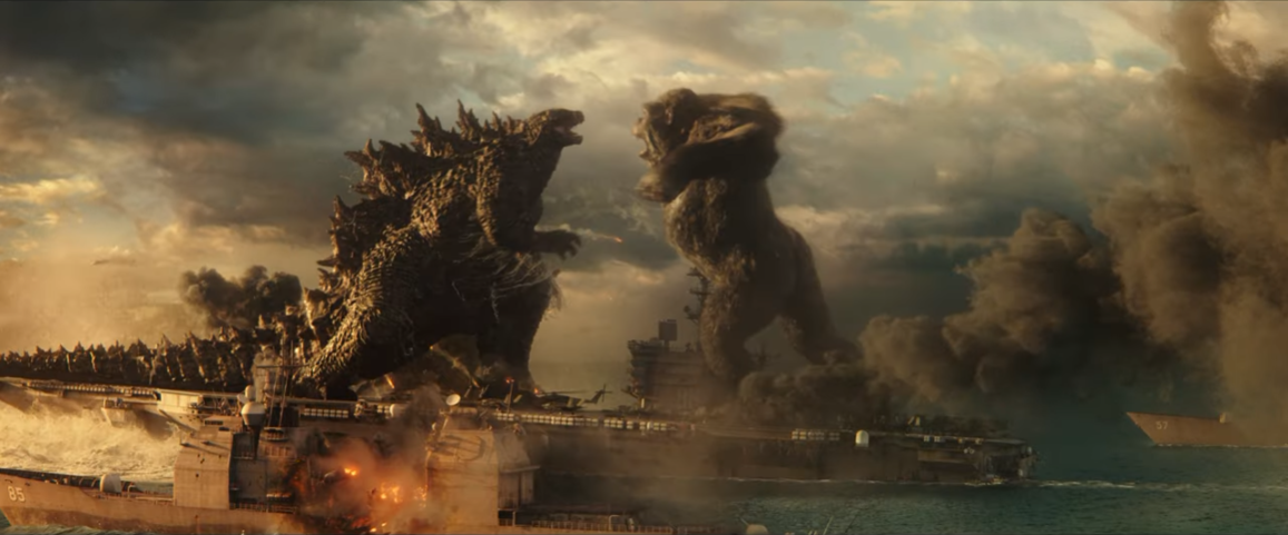 Godzilla and Kong face off on the deck of a battleship in the middle of the ocean in a climactic scene from the upcoming Godzilla vs. Kong theatrical film.