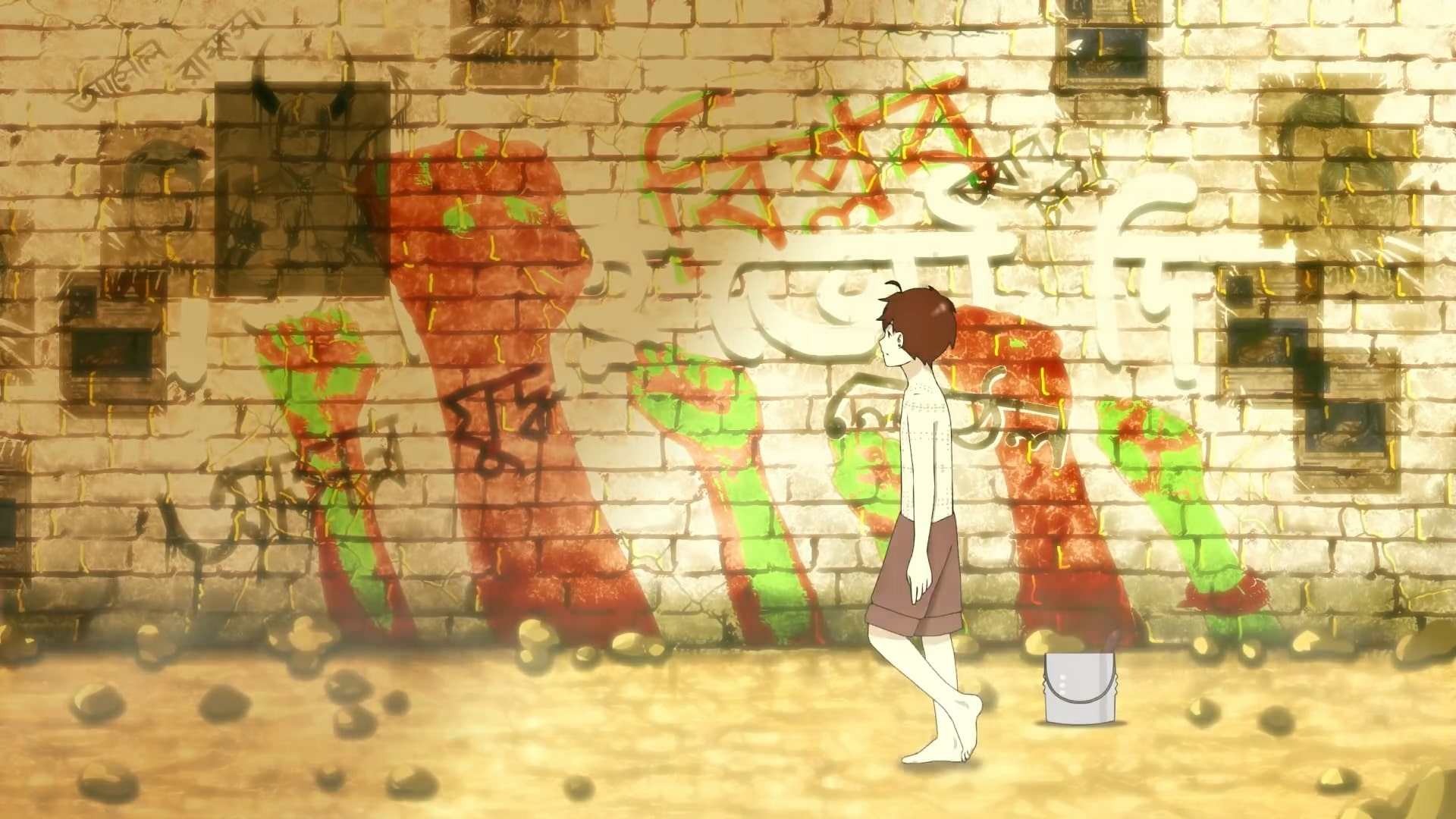 Boy stares at graffiti on a wall