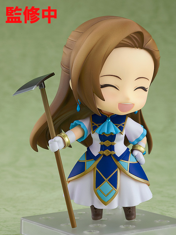 A promotional image of the Nendoroid Catarina Claes toy from Good Smile Company, emphasizing the smiling face and the garden hoe accessory of the heroine of My Next Life as a Villainess: All Routes Lead to Doom!.