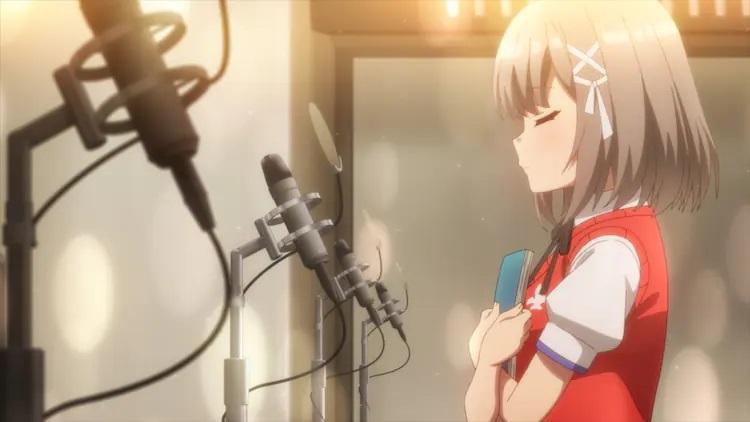 ¡La protagonista Haruna Mutsuishi se prepara para dar una lectura de voz en off en un estudio de grabación en una escena del próximo CUE!  Anime de TV.