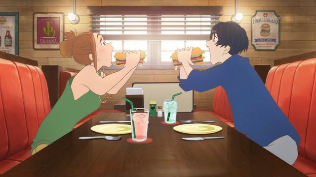 Hinako and Minato prepare to chow down on huge hamburgers in Ride Your Wave.