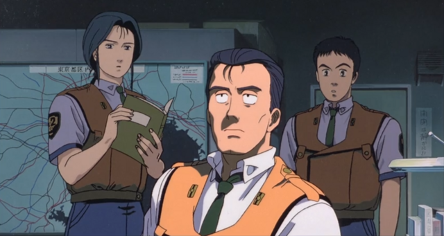 Shinobu Nagumo, Kiichi Goto, and Asuma Shinohara brainstorm how best to investigate Eiichi Hoba's terrorist conspiracy.