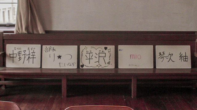 The girls from K-ON! name cards in real life