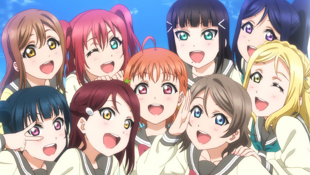 A group shot showing the members of Aquors, a school idol group, from the Love Live!! Sunshine!! TV anime.