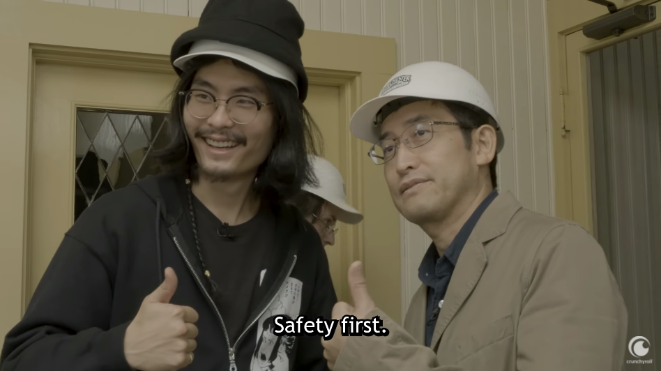 Host Tim Lyu and horror manga author Junji Ito don safety helmets and flash a thumbs-up as they continue explore some of the more cramped environments within the Winchester Mystery House in San Jose, California.
