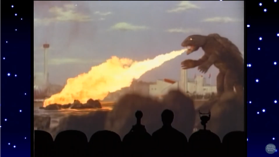 Joel, Tom Servo, and Crow T. Robot riff on Gamera breathing fire in a scene from a classic episode of MYSTERY SCIENCE THEATER 3000.