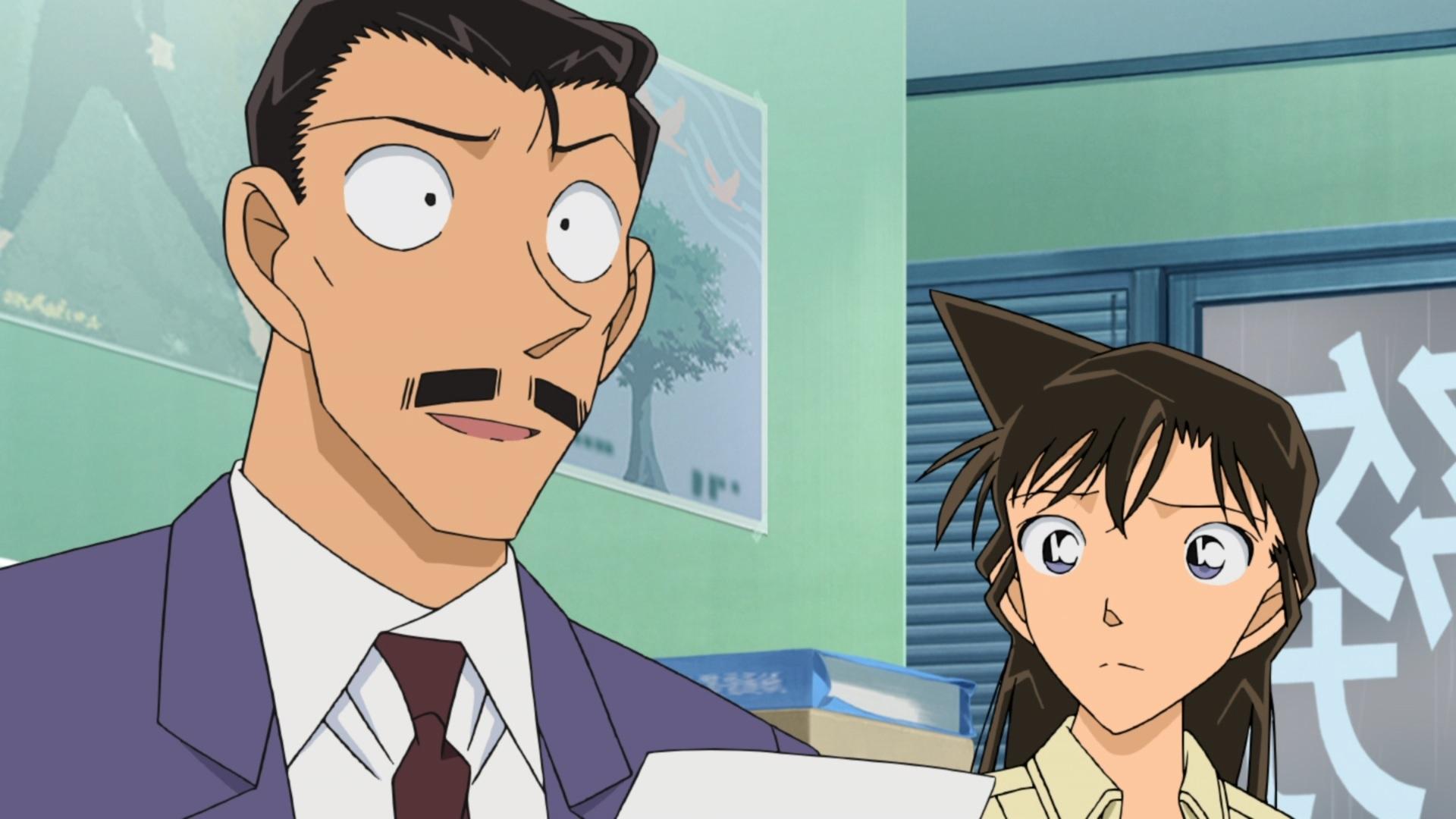 Kogori Mori intenta consolar a un cliente potencial en una escena del anime de televisión Case Closed / Detective Conan.