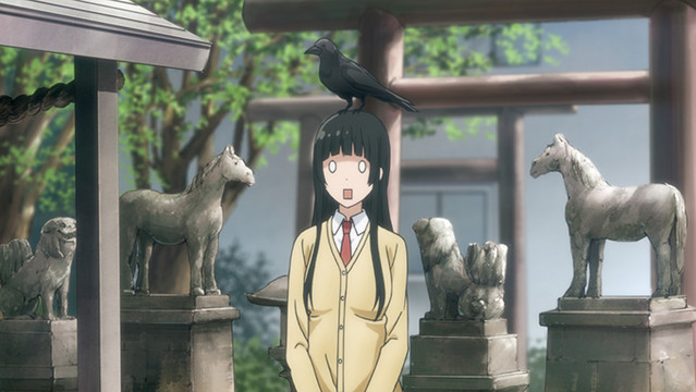 A crow unceremoniously perches on Makoto's head after a summon spell turns out to be a little too effective in a scene from the Flying Witch TV anime.