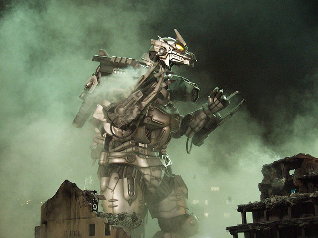 Kiryu, the mechanical anti-Godzilla weapon, puts up its dukes and prepares to tussle in a ruined city.
