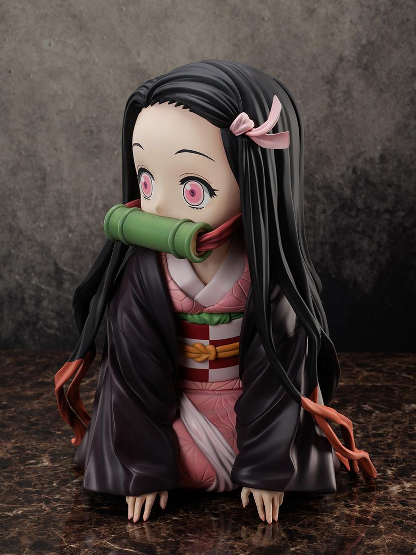 "A promotional image of the ""Demon Slayer: Kimetsu no Yaiba Boxed Nezuko Big Size Figure"" from FuRyu Corporation, depicting a medium 3/4 profile shot of Nezuko."