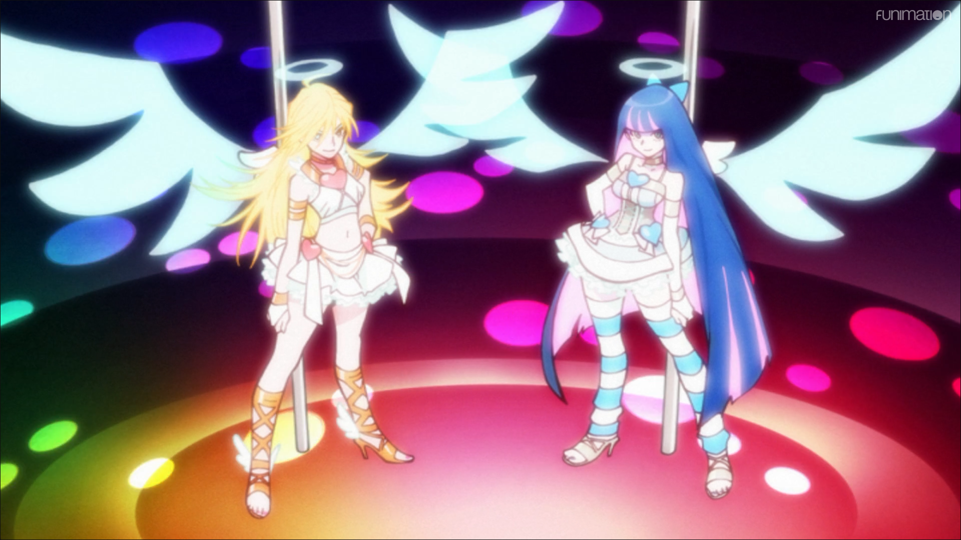 Panty and Stocking prepare to perform their pole-dance transformation sequence in a scene from the Panty & Stocking with Garterbelt TV anime.