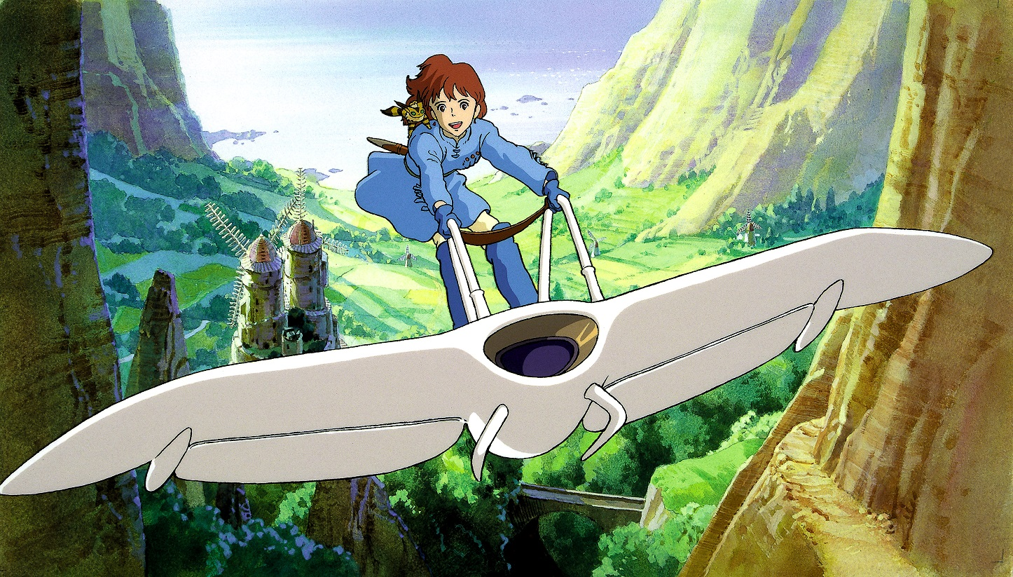 Princess Nausicaä along with her fox-squirrel companion Teto soar above the Valley of the Wind on Nausicaä's glider in a promotional image for the 1942 film, Nausicaä of the Valley of the Wind.