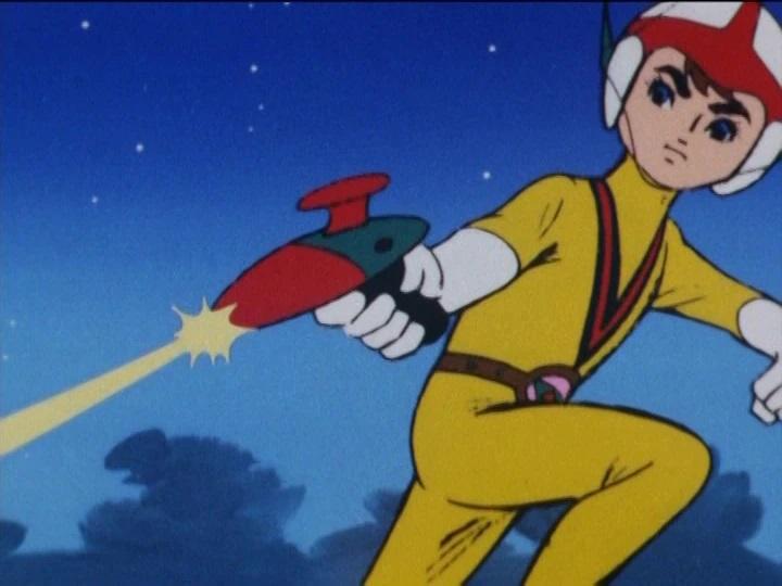 Ken dispara su Alpha Gun en una escena del anime de televisión Chargeman Ken de 1974, animado por Knack Productions.