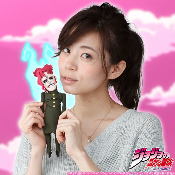 A model poses with the JoJo's Bizarre Adventure Soul-Removed Noriaki Kakyoin Puppet Mascot Pouch from Premium Bandai in a promotional image for the product.