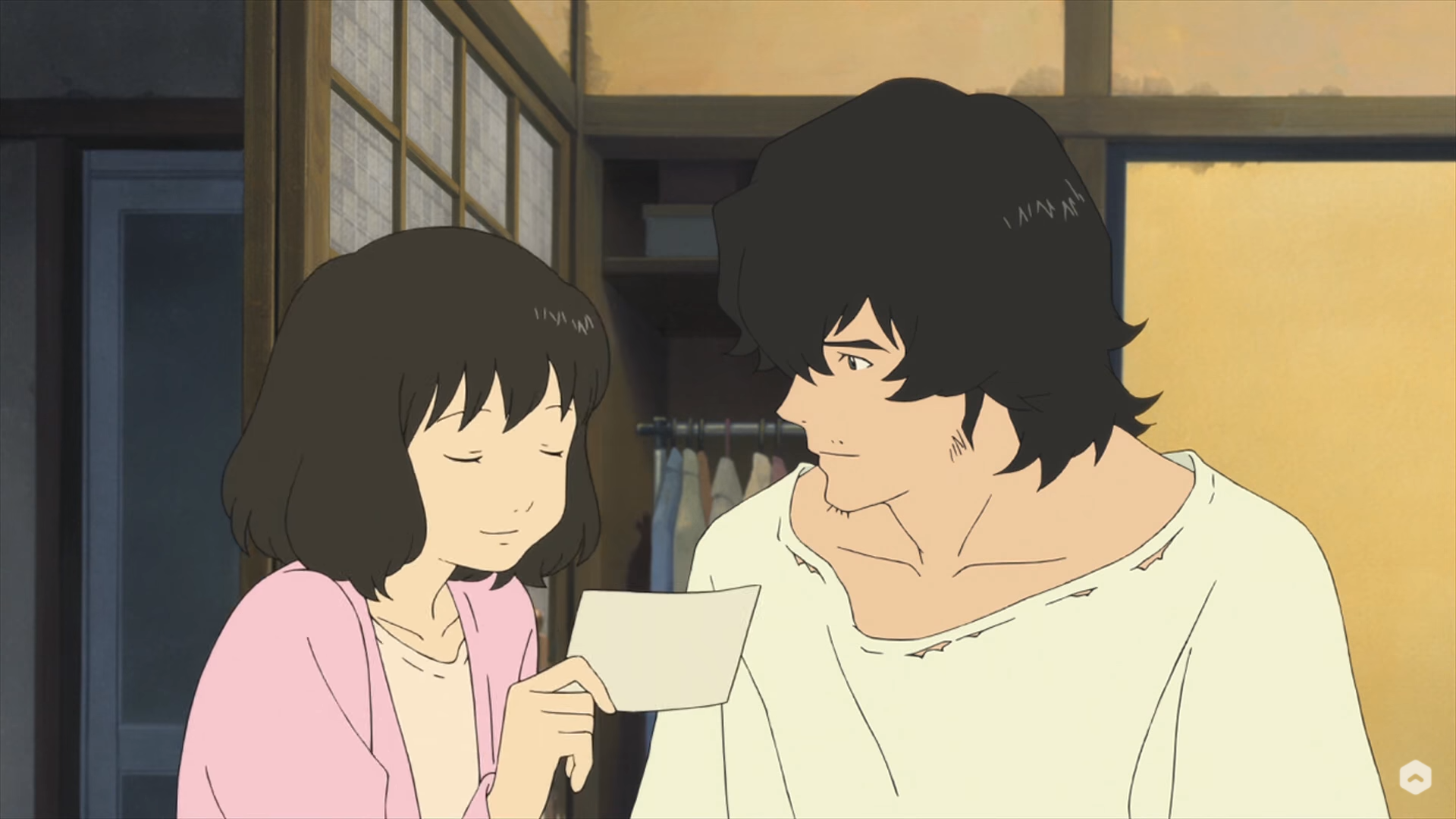 Hana shares a moment with her partner in Wolf Children