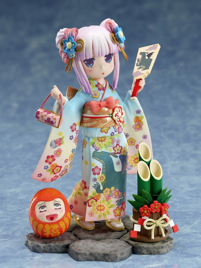 A promotional image of the Miss Kobayashi's Dragon Maid Kanna - Fine Clothes - 1/7 Scale Figure by FuRyu, emphasizing Kanna's fine kimono outfit, wooden paddle, and good luck accessories such as a kadomatsu and a Daruma doll.