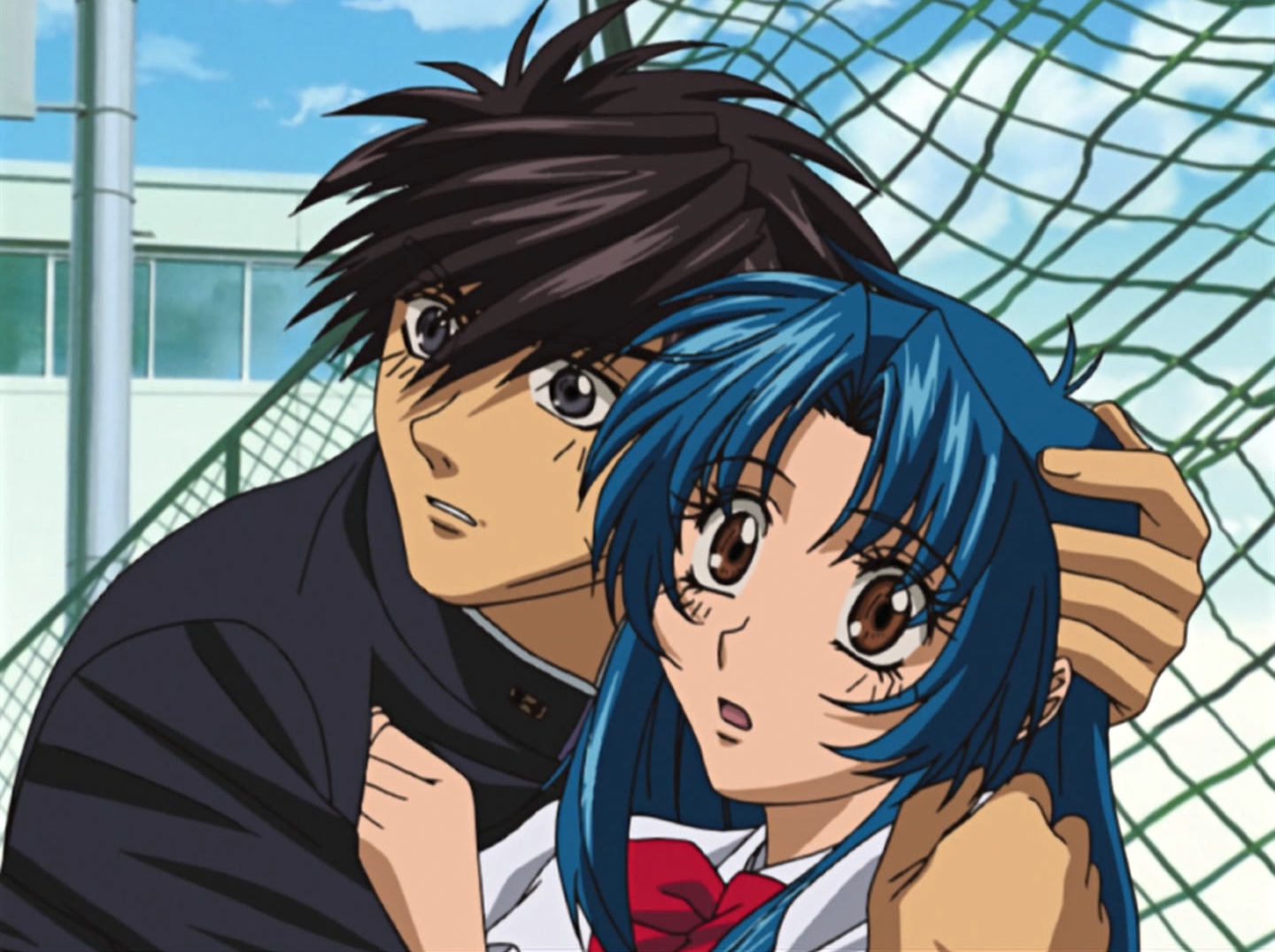 Sousuke attempts to protect Kaname from a perceived threat in a scene from the Full Metal Panic! TV anime.