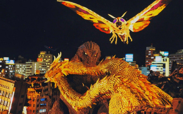 Possessed by the ghosts who perished in the Pacific Theater of WWII, a monstrous Godzilla puts the bite on a weakened King Ghidorah while Mothra attempts to intervene.