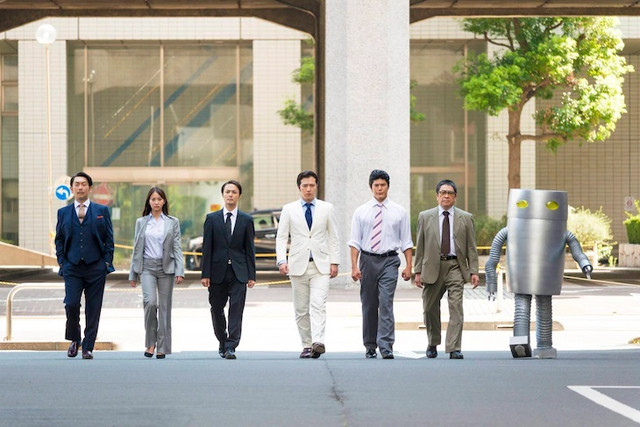 A promotional image for the upcoming Kachou Baka Ichidai TV drama, featuring the employees of Matsushiba Electric Appliances.