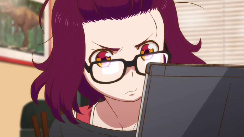 Heroine Mei Kamino studies a computer screen with a serious expression on her face in a scene from the upcoming Godzilla Singular Point TV anime.