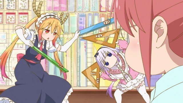 Tohru and Kanna spar with rulers and drafter's triangles while Kobayashi looks on in bemusement in a scene from the 2017 Miss Kobayashi's Dragon Maid TV anime.
