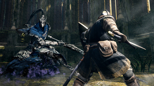 A Chosen Undead clad in full plate armor and wielding a sword and shield faces off against the corrupted Artorias the Abyss-Walker boss in a scene from the PS4 version of the Dark Souls: Remastered video game.