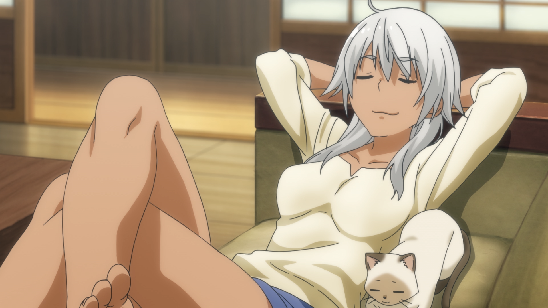 Akane Kowata and her familiar, Kenny, loaf on the couch in a scene from the Flying Witch TV anime.