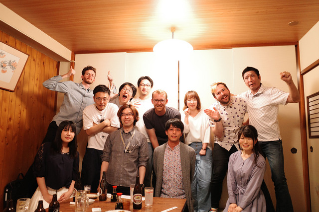 Our production team with the staff of Dr. STONE