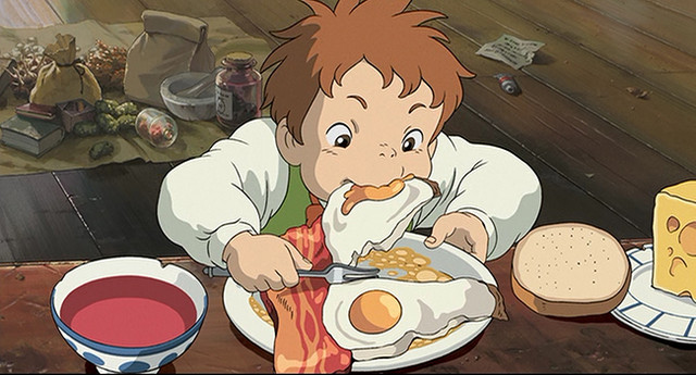 Markl chows down on a hearty breakfast of bacon and eggs in a scene from the 2004 Studio Ghibli film, Howl's Moving Castle.